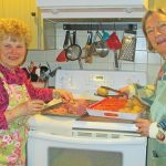 Chief chefs Sandy Warhol and Josie Thorpe, from left, do a trial run on cooking the beef and vegetables. Photo by Betty Wrenn Day